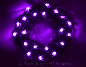And yet another wreath to scare the bejesus out of arachnaphobes. Doesn't hurt if the spiders are lighted up purple, too.