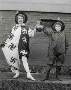 This picture was taken in Nazi Germany. That's why the kid's clown costume has swastikas on it. Yes, I know it's very offensive.