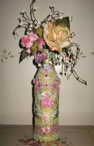 Okay, the flowers are fake and the bottle is covered in cloth. But it might look great on a mantle or table.