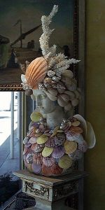 This is another one of those figures they decorate with seashell. But this one seems to take shell adornments to a whole new level.