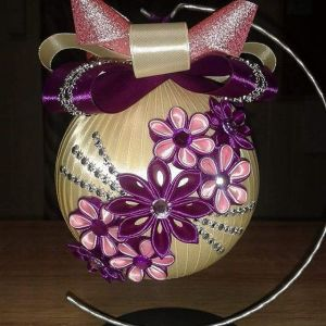 These flowers are quite lovely on this off white Christmas ornament, Love the ribbons, too.