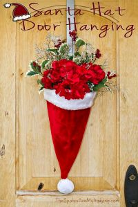 Flowers inside a Santa hat? Sure they're not poinsettias but they'll do quite nicely here.