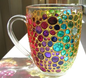 No, this isn't a hallucination. The cup is designed this way with all the colorful bubbles. Not sure if it's an improvement.