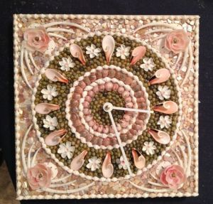 Yes, it's another seashell clock. But this one is pink and in mosaic form.