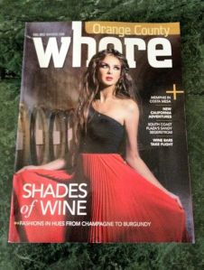 "It's actually titled Where magazine. But the fact the woman covers part of the ""e"" seems to suggest otherwise."