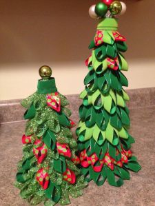 Both are mostly green with some red ribbon for trimmings. They also have shiny balls on top.