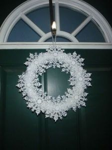 This is another easy wreath. Just need a hoop, white yarn, and craft snowflakes. Lovely.