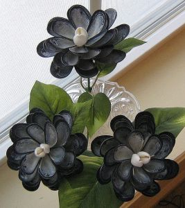 Well, they have mussel shell petals and a snail center. And yes, they look quite lovely with fake stems and leaves.