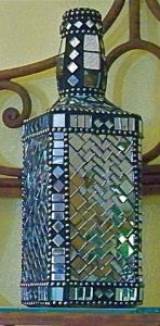 Well, it's a lovely mosaic bottle with mirror bits. Bet it'll look great on a mantle. Love it.