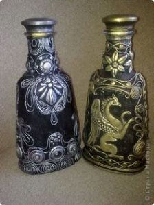 These are glass bottles that are painted and have clay on them to seem like they're metal. Love the artistic touch.