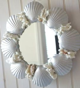 Love the shiny shells on this one. Gives this mirror a certain beach side elegance.