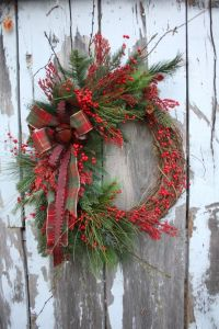 Now this is the kind of holly wreath to put on one's front door. Love the plaid ribbon.
