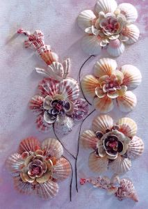 Yes, this is a seashell flower arrangement. Yes, it probably took a lot of time and energy to make. But it's surely a thing of beauty.