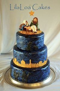 This one has the Holy Family and the Star of Bethlehem on top. While the town of Bethlehem is on a lower tier. Yet, all the cake is iced dark to resemble night.