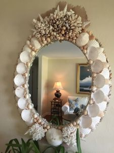 Guess this mirror took a lot of time to make from the looks of it. Yet, it seems perfect for any beach side living room or bedroom.