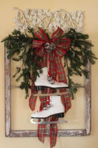 This one features a pair of ice skates in a frame with branches and a plaid bow. Has quite a rustic touch.