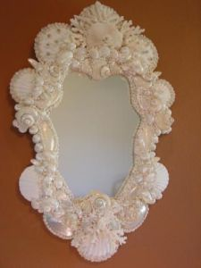 Again, I know I've shown a lot of mirror frames on here. But I assure you this white one does have a pearly finish to it. Lovely.