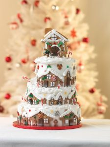 Unlike the gingerbread village cake I showed last year, this one has houses built on the cake tiers. Also, like the happy gingerbread people.