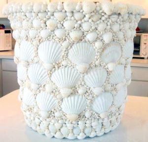 Yes, this pot is decorated with fine white shells. Still, you can't help but love this one.