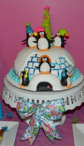 The penguins even has a Christmas tree. And they're standing on top of the igloo to sing. So cute.