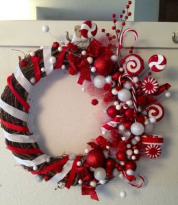 Well, it's surely a very candy cane colored wreath. Love the lollipops and mints. Stunning.