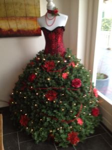 This one is decked with roses, poinsettias, and lights. Such a great Christmas dress it is.