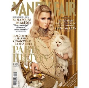 "From Carolyn Collado: ""Greg Lotus image for Paris Hilton for Vanity Fair Spain in January 2012 looked stunning and perfect if only for the fact that we are kinda confused whether the magazine really tapped the hotel heiress for the cover or did they have Paris Hilton's wax figure covered on her behalf? The excessive retouching defeated the purpose of glamour that we rather pay more attention to her cute pup."""