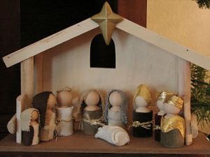 This one has a stable as well as the peg figures in clothes. Love the gold turbans on the wise men.