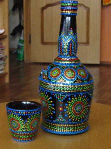 As you can see here, the bottle and glass each are uniquely decorated in the same pattern. Still, I think these are lovely in their own way.