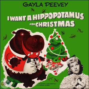 You probably remember the song on this album. But at least the cover goes to great lengths why any child shouldn't want a hippopotamus for Christmas. I mean hippos kill more people in Africa than lions.