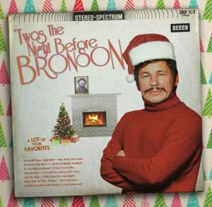 I find it hard to imagine a guy like Charles Bronson having a Christmas album unless it includes anything revenge oriented. Also, that Christmas hat doesn't help matters at all.
