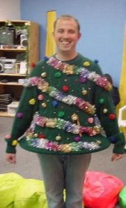 This guy has rainbow tinsel and pom pom ornaments. And he stands out tacky and proud.