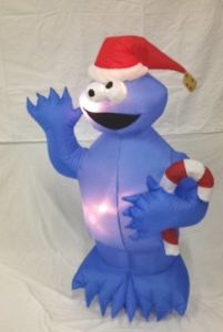 Why does this Cookie Monster inflatable have a candy cane? He should more likely have a gingerbread man cookie in his hand. That would've been more appropriate.