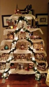 This even fancier than the other stepladder display. Even has lights and garland on it.