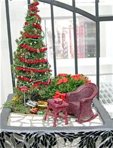 Helps if the bush has red bows, too. Not to mention, the gifts near the tree bring an extra holiday touch.