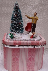We see him here decking his tree with silver trees. Of course, he tends to make a mess.