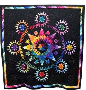 Another quilt in a rainbow color scheme. But this one is in a star configuration.
