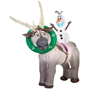 Sven even has a Christmas wreath on him as Olaf rides on top of him. Sure it's from Frozen but it melts your heart.