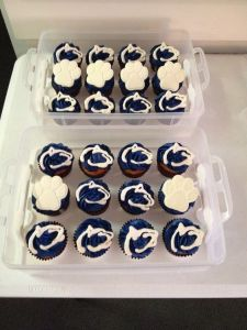 Well, these consist of cupcakes with the Penn State logo and white pawprints. I'm sure they'll eat these up at Happy Valley.
