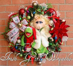 This one has Kermit dressed as Santa and Piggy in a green dress and fur coat. Hope Piggy doesn't have PETA get on her case.