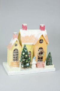 This one has a nice sunny disposition with its orange snow capped roof. Love the tree and snowman in front.