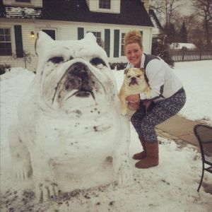 Unfortunately, her special four legged friend doesn't seem too amused by her snow dog creation. Still, it's a work of genius.