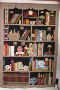 I know it's another bookshelf quilt. But this one seems more suited for a study.