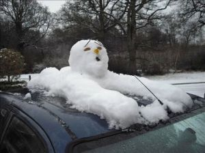 A snowman has to hitch a ride somehow. Because he can't be in where there's seatbelts or he'd melt.