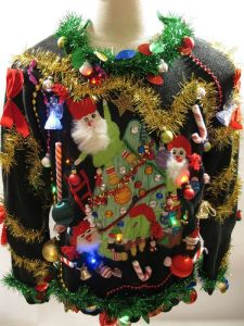 Well, they kind of resemble garden gnomes. Still, this sweater has plenty of tacky trimmings to set your season right.