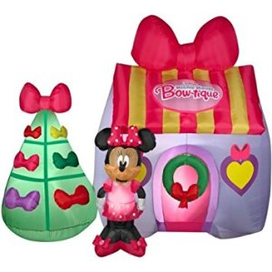 You see, Minnie Mouse is all ready for Christmas. Her Christmas tree is even full of bows like her house.