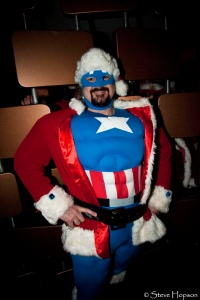 This is Captain America as Santa Claus. Notice how he has great abs and a red suit.