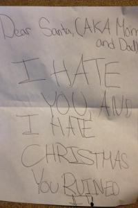Guess this kid saw Mommy kissing Santa Claus last Christmas. Seems to be a little Grinch in the making.