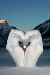 This one uses two giant hands made out of snow. But it's guaranteed to warm your heart.