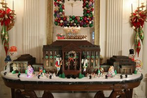 "Caption: ""WASHINGTON, DC - DECEMBER 02: A chocolate gingerbread house is on display in the State Dining Room during first lady Michelle Obama's preview of the 2015 holiday decor at the White House December 2, 2015 in Washington, DC. As part of the Joining Forces initiative, the first lady welcomed military families to the White House for the first viewing of the 2015 holiday decorations."" To be fair, a gingerbread White House is kind of a holiday tradition since the Carter Administration."